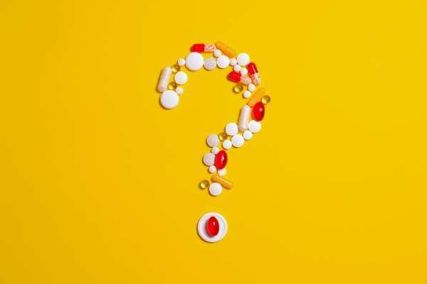 Pills in a question mark shape