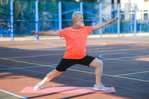 older man in yoga pose
