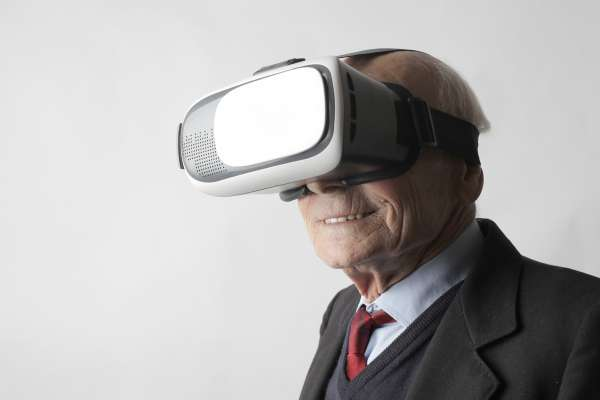 older man wearing virtual reality headset viewer
