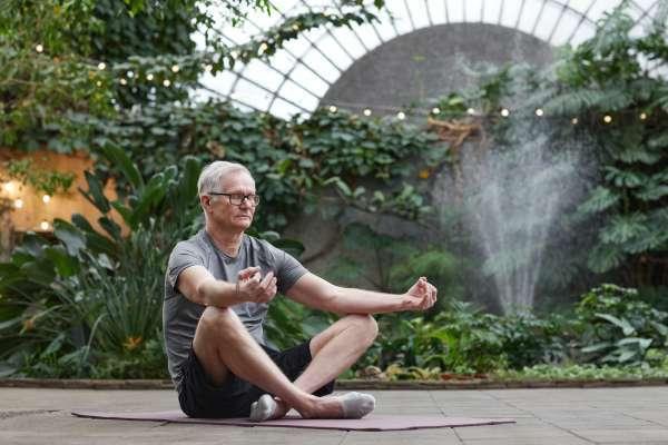 older adult seated for meditation